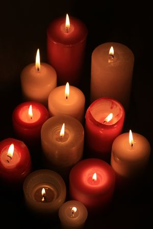 A group of burning candles in red and white Stock Photo - 5841478