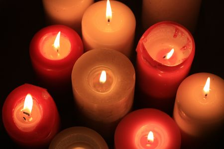 A group of burning candles in different colors Stock Photo - 5841483