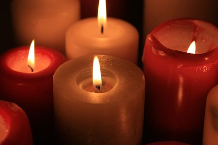 A group of burning candles, red and white Stock Photo - 5841484