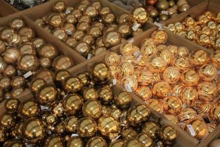 Boxes with golden christmas balls for sale in a shop photo