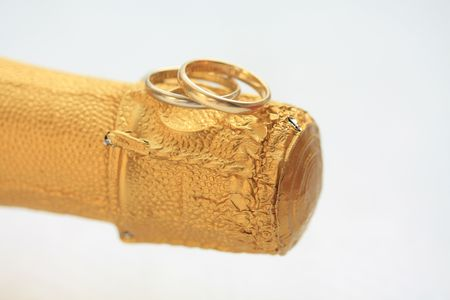 Two wedding bands on a champagne cork Stock Photo - 5888853
