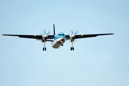 propeller plane approaching the runway photo