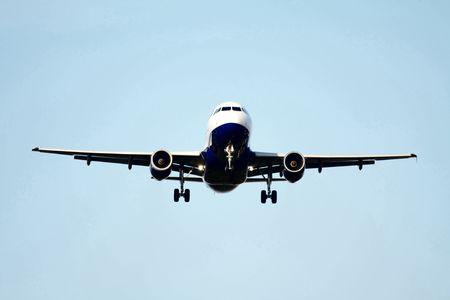 A plane approaching the runway, landingsgear out