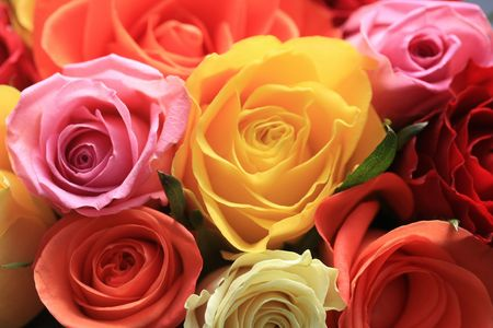 Rose bouquet with roses in pink, white, yellow and orange photo