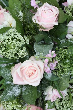 A pink rose flower arrangement with matching flowers in the snow Stock Photo - 6204221