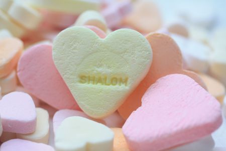 shalom: yellow valentine candy heart with Shalom text Stock Photo