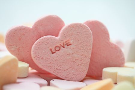 pink candy hearts with the word love photo