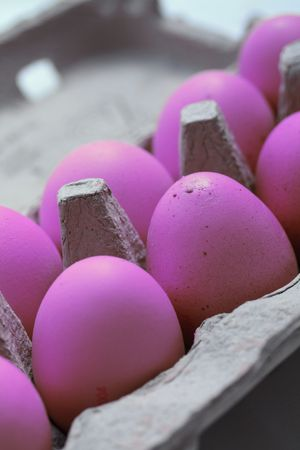 wicker: A carton with purple eggs for easter