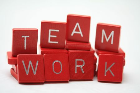 Teamwork written in little red blocks Stock Photo