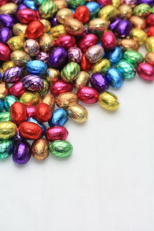 easter decorations: A pile of colored easter chocolate eggs with copy space Stock Photo