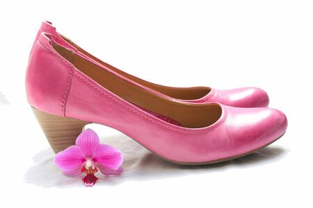 ladies shoes: A pair of pink leather ladies shoes and a pink orchid Stock Photo
