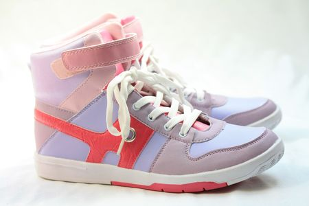 sho: A pair of fashionable sneakers, pink and lila