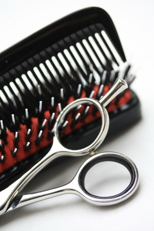 A pair of hairdressers scissors, a comb and a brush, the basic equipment for any hairdresser Stock Photo - 7202690
