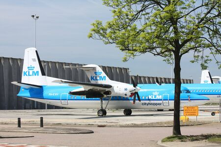 schiphol: A couple of Fokker 50 airplanes on an abbandoned parking lot near Amsterdam Airport Schiphol Editorial