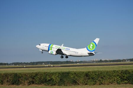 schiphol: July 24th 2010, PH-XRX - Transavia Boeing 737-700 taking off from Amsterdam Airport Schiphol Editorial