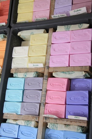 french perfume: Colorful bars of soap, a local product of the Provence. Displayed in boxes on a market in Bédoin
