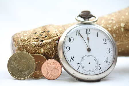 A champagne bottle, a vintage pocket watch and three euro coins making 2011. Perfect New Years greeting card photo