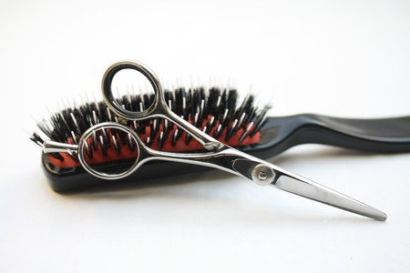 Basic hairdressers tools: pair of scissors and  a brush photo
