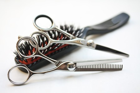 Basic hairdressers tools: two pairs of scissors and  a brush photo