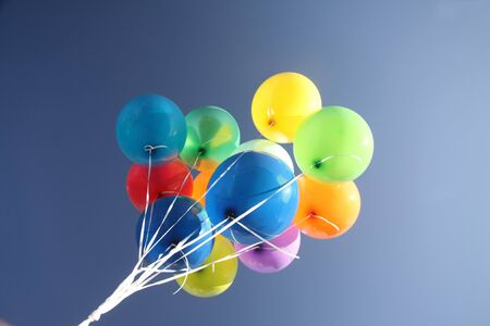 balloons  green: Colorful balloons in a bright blue sky Stock Photo