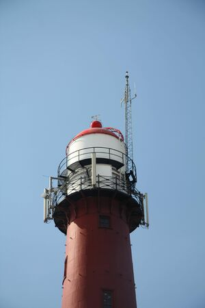 Old steel lighthouse near the harbour of IJmuiden, the Netherlands Stock Photo - 9728454
