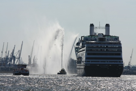 holidays vacancy: Rotterdam, june 2nd. 2011 HAL cruise ship Rotterdam leaving the harbour Editorial