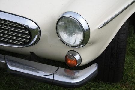 noord: August 6th, 2011 Oldtimershow Santpoort Noord, the Netherlands Vintage white 1969 Volvo 1800 detail