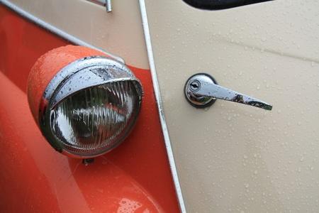 noord: August 6th, 2011 Oldtimershow Santpoort Noord, the Netherlands 1960 BMW Isetta 300, detail of head light