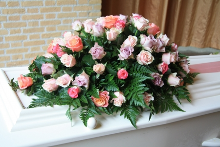 White casket covered with floral arrangements at a funeral service Stock Photo - 11194227