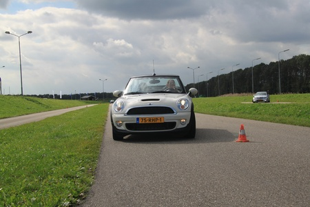 september 23rd, 2011 Lelystad, the Netherlands, Goodyear Safe Drive Experience. Testing Run on Flat technology tires with a Mini Cooper Stock Photo - 11128689