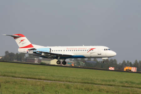 september, 3rd 2011, Amsterdam Schiphol Airport Austrian Arrows Fokker 70 OE LFH landing on Polderbaan Stock Photo - 11719889