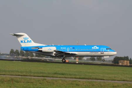 schiphol: september, 3rd 2011, Amsterdam Schiphol Airport KLM PH-KZA Cityhopper Fokker 70 landing on Polderbaan