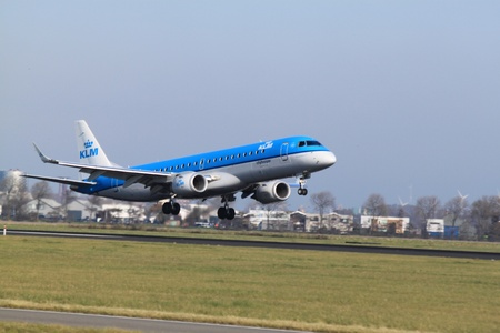 October, 22nd 2011, Amsterdam Schiphol Airport KLM Cityhopper PH-EZF Embraer 190 landing on Polderbaan Stock Photo - 11719925