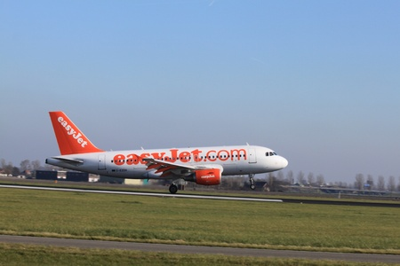 schiphol: October, 22nd 2011, Amsterdam Schiphol Airport Airbus A319-111, G-EZDV, EasyJet landing on Polderbaan