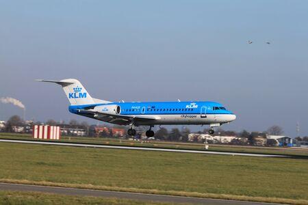 schiphol: October, 22nd 2011, Amsterdam Schiphol Airport - PH-KZE - KLM Cityhopper - Fokker F70  landing on Polderbaan