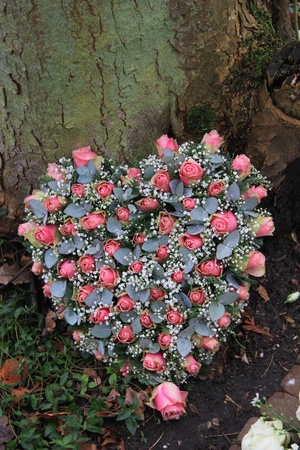 sympathy flowers: Pink heartshaped sympathy flowers near a tree, roses and eucalyptus