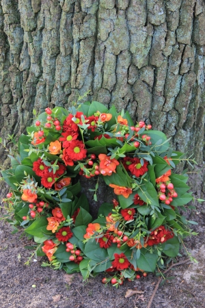 sympathy flowers: Mixed red flowers in a sympathy flower arrangement