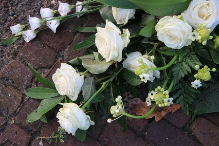 sympathy flowers: Sympathy flower arrangement with white roses and lilies