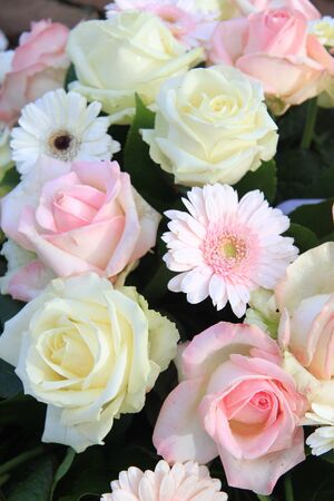 pink and white mixed floral arrangement roses and gerberas photo