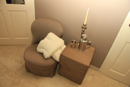 luxery: Classic chair and hocker styled with silver accessories