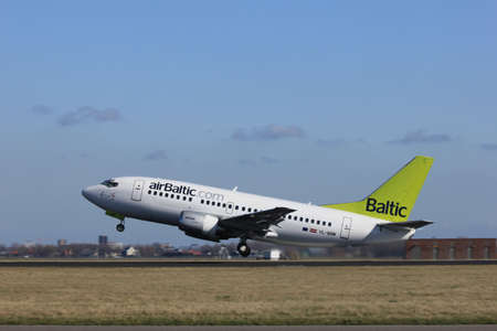 polderbaan: March, 11st 2012, Amsterdam Schiphol Airport YL-BBM Air Baltic Boeing 737-522 take off from Polderbaan Runway