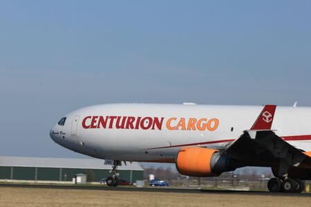 March, 11st 2012, Amsterdam Schiphol Airport N985AR Centurion Cargo McDonnell Douglas MD-11F take off from Polderbaan Runway