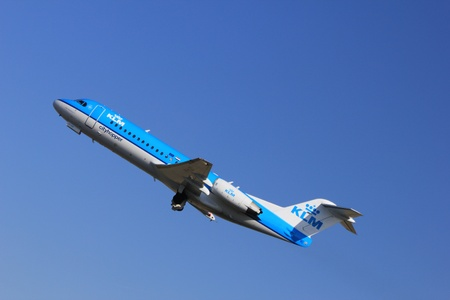 March, 11st 2012, Amsterdam Schiphol Airport PH-KZD KLM Cityhopper Fokker F70  take off from Polderbaan Runway