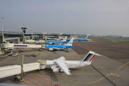 March, 24th, Amsterdam Schiphol Airport Planes waiting on the gate, waiting to depart or just arrived Stock Photo - 12848367