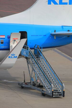 March, 24th, Amsterdam Schiphol Airport the Netherlands: airplane on the gate, rare exit detail Editorial