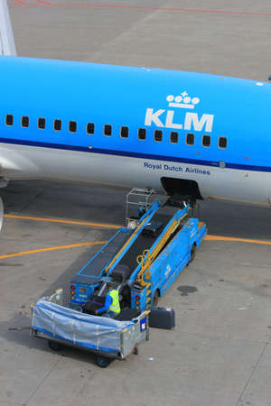 schiphol: March, 24th, Amsterdam Schiphol Airport the Netherlands: loading baggage to an airplane