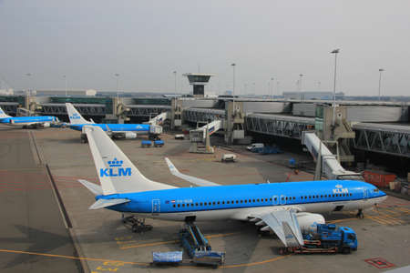 fueled: March, 24th, Amsterdam Schiphol Airport Planes on the gate, getting fueled and freight has been loaded