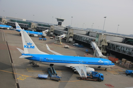 March, 24th, Amsterdam Schiphol Airport Planes on the gate, getting fueled and freight has been loaded Stock Photo - 12848417