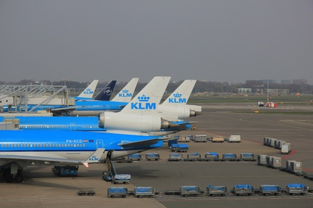 just arrived: March, 24th, Amsterdam Schiphol Airport Planes waiting on the gate, waiting to depart or just arrived Editorial