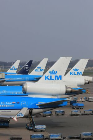 March, 24th, Amsterdam Schiphol Airport Planes waiting on the gate, waiting to depart or just arrived Stock Photo - 12848371